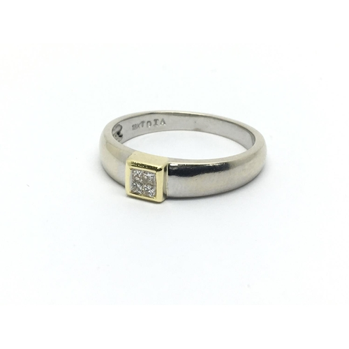 46 - An 18ct white gold ring set with four small princess cut diamonds, approx 3.3g and approx size N....