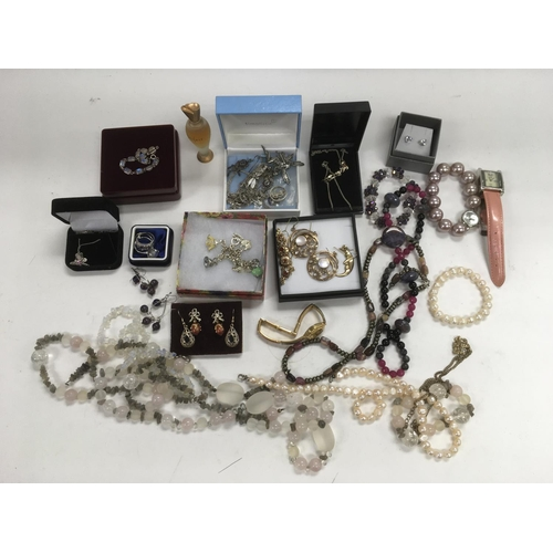 57 - A collection of costume jewellery, a Burberry silk scarf and one other....