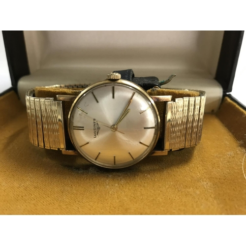 60 - A Longines wrist watch with gold plated strap and a original box...