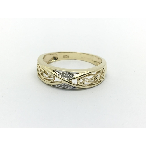 8 - A 9ct gold open work ring set with small diamonds, approx 2.2g and approx size N....
