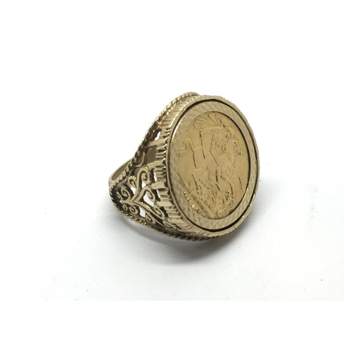 10 - A 9ct gold ring inset with a full sovereign dated 1913, approx 15.4g and approx size R-S....