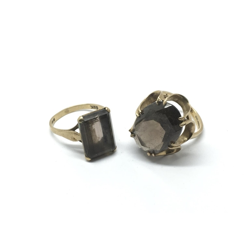 11 - Two 9ct gold rings set with quartz stones, approx 9.2g, approx sizes M and N-O....