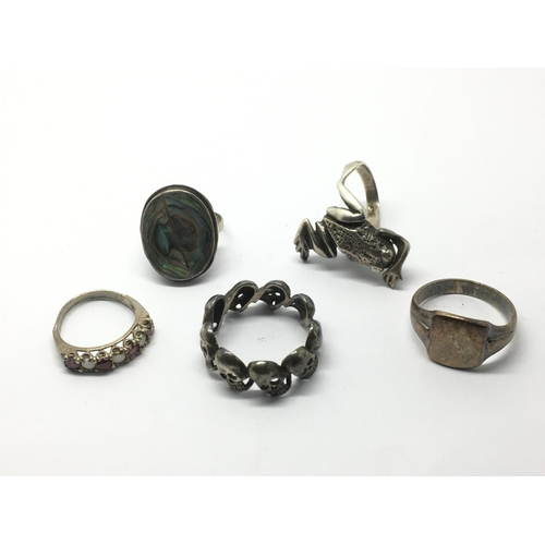 14 - Five silver rings, one in the form of a frog, one set with skulls plus three others....