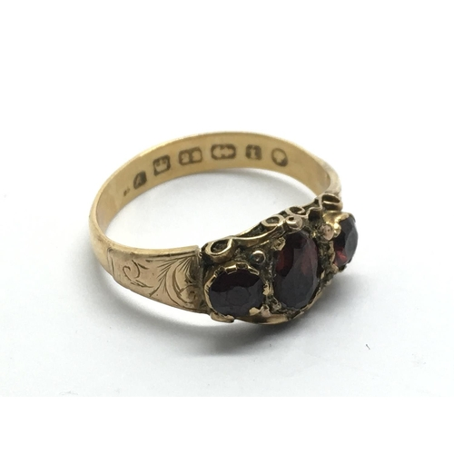 20 - An antique 22ct gold ring inset with garnets, approx 2.8g and approx size L-M....