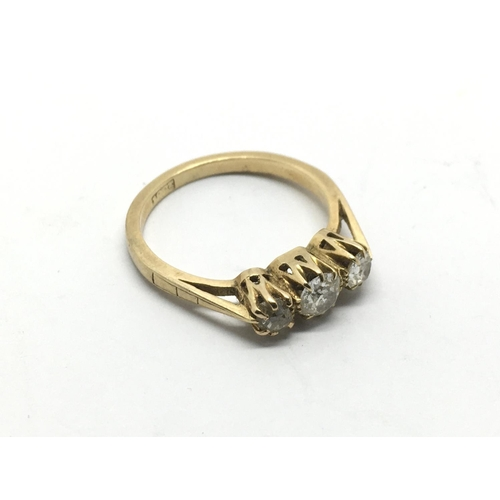 21 - An 18ct gold ring set with three old cut diamonds, approx 3g and approx size L....