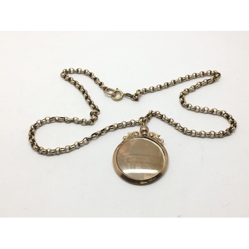 23 - A 9ct gold belcher chain with an open face locket, approx 10g....