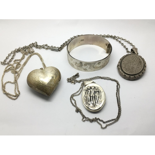 24 - Three silver lockets, one in the shape of a heart plus a silver bangle (4)....
