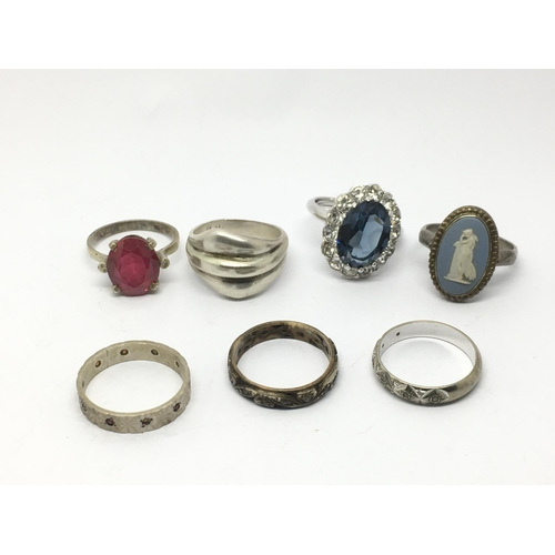 25 - A collection of seven silver rings....
