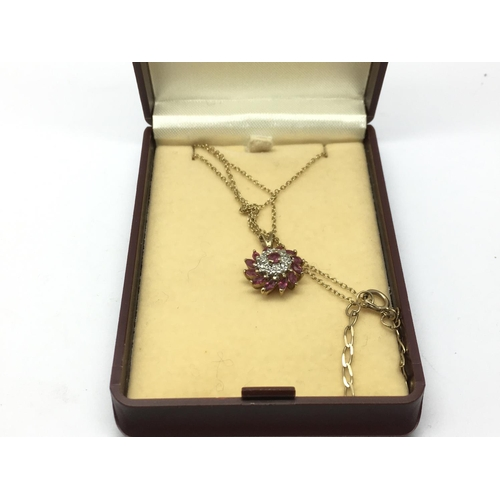 28 - A 9ct gold pendant set with rubies and small diamonds, approx...