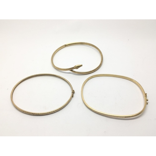 30 - Three 9ct gold bangles, approx 11.6g....