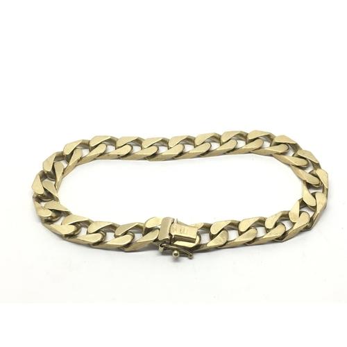 33 - A heavy 9ct gold slab sided bracelet, approx 36g....