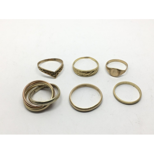 39 - A collection of six 9ct gold rings including a Russian type wedding ring, approx 12.7g.