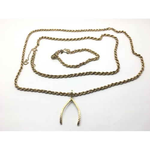 40 - A 9ct gold rope chain with a wishbone pendant plus one other rope chain and matching bracelet (3)....