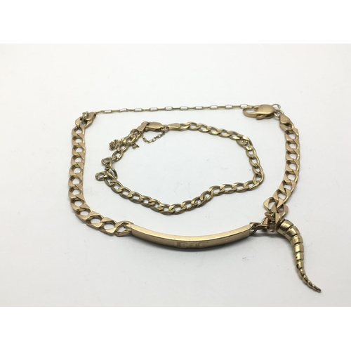 42 - A 9ct gold bracelet with inscription and horn of life pendant and one other bracelet, approx 16.6g....