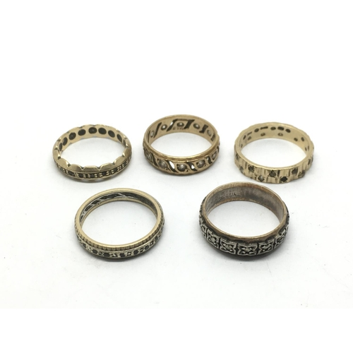 45 - A collection of worn gold and silver eternity rings....
