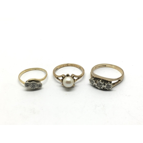 47 - Two 9ct gold rings set with chip stone diamonds together with one other gold ring set with a pearl, ...