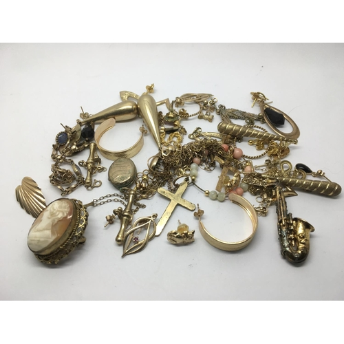 48 - A collection of unmarked gold, gold earrings and other oddments including a cameo, approx 55g....