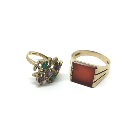 49 - Two 9ct gold rings set with coloured stones, approx 8.8g and approx sizes U and M-N....