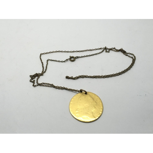 5 - A worn George III golden guinea coin converted in to a pendant, approx 7.9g....