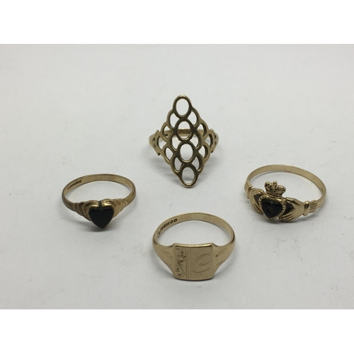 51 - Four gold rings, two inset with onyx, approx 7g....
