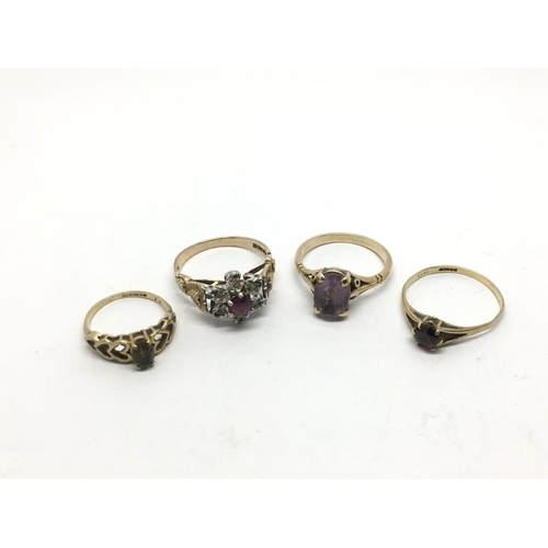 52 - Four gold rings set with stones comprising ruby, diamond, amethyst and quartz, approx 7.8g, various ...