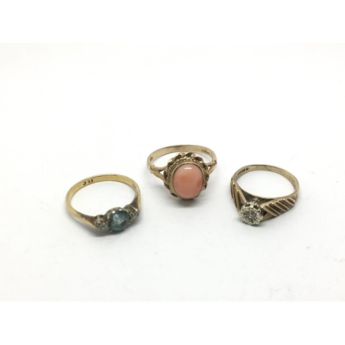 55 - Three gold rings comprising one set with diamond chips, aquamarine and a coral coloured stone, appro...