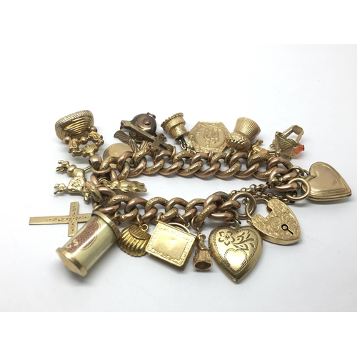 7 - A 9ct gold charm bracelet with a rose gold bracelet, various charms, approx 56g....