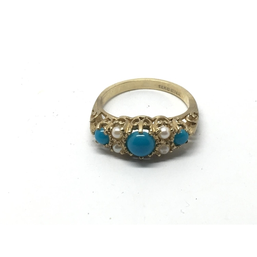 9 - A 9ct gold ring set with turquoise and cultured pearls, approx 3.2g and approx size N-O....