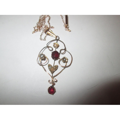 11 - 9 ct gold necklace set with seed pearls and garnets on 9 ct gold chain in a presentation case...