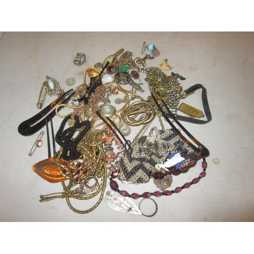 23 - Tub of costume jewellery : necklaces, brooches earring etc....