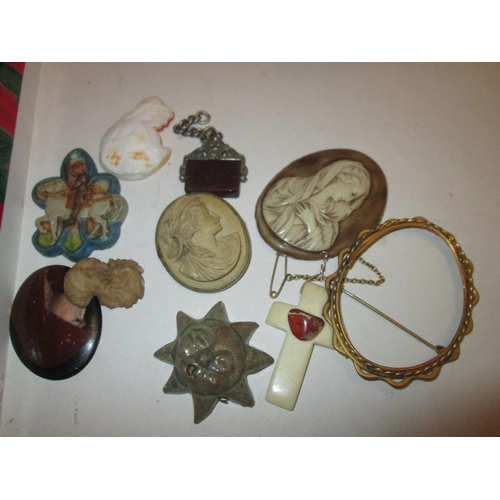 27 - Bag of cameo and other plaques, crucifix etc....