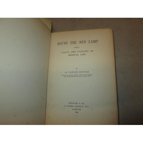 30 - Hardback bound in maroon red cloth with gold lettering on spine : Round the Red Lamp by A Conan Doyl...