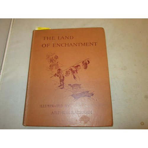 8 - Hard Back in orange / brown cloth with design and lettering on both F/board and spine : The Land of ...