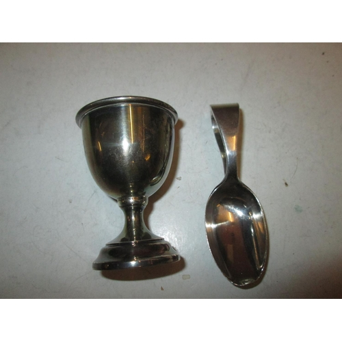 11 - Silver egg cup and feeding spoon 45 g...