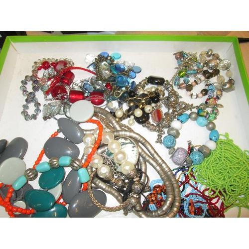 7 - Bag of assorted costume jewellery...