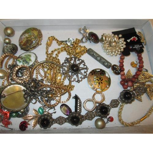 47 - Bag of costume jewellery, silver brooch...
