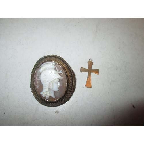 48 - Unmarked but tested 9 ct gold cameo of a Neo Classical figure and 9 ct gold Crucifix...