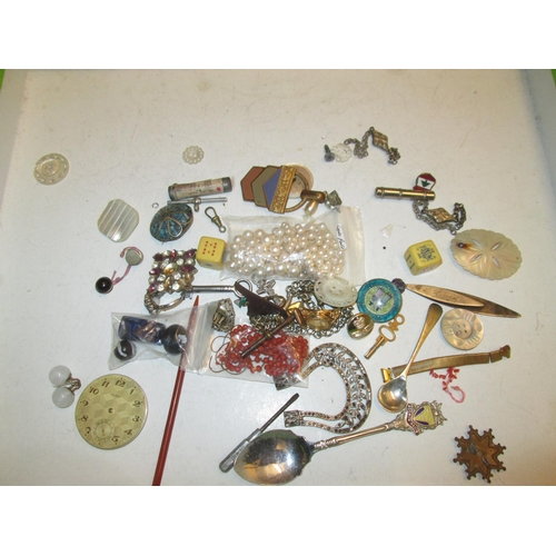 54 - Bag of costume jewellery, some silver included, watch key etc....