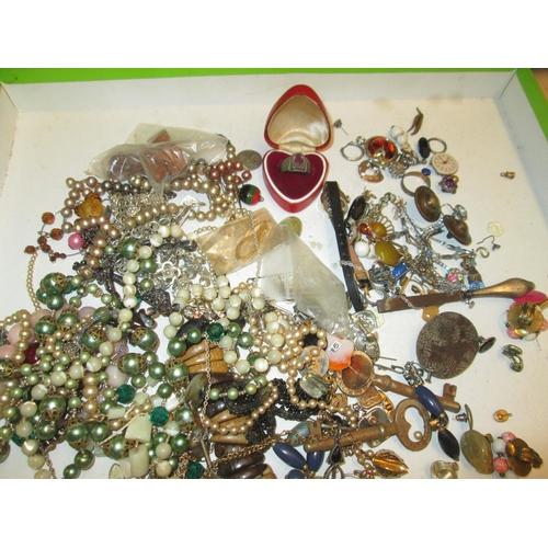 55 - Bag of costume jewellery, small amount of silver included...