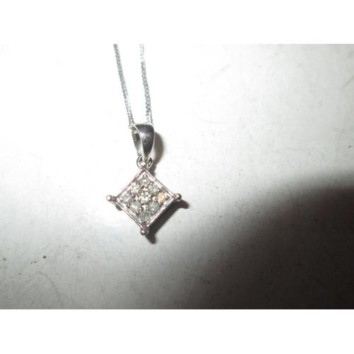 57 - White gold pendant set with small diamonds 1.3 g...