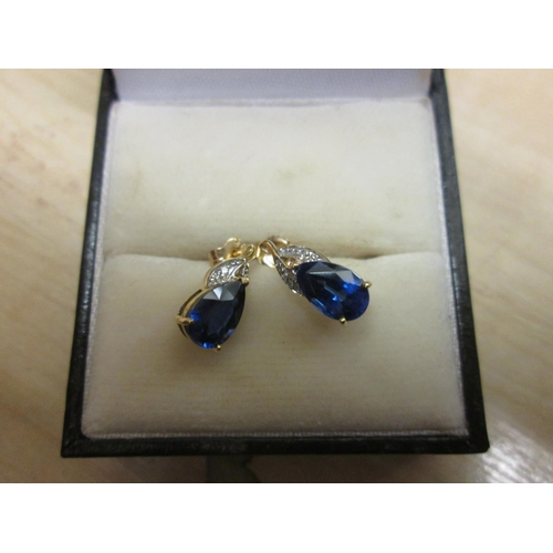64 - Pair of 9 ct gold diamond and sapphire earrings...