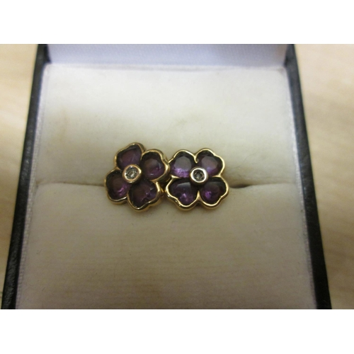 65 - Pair of 9 ct gold diamond and amethyst earrings...