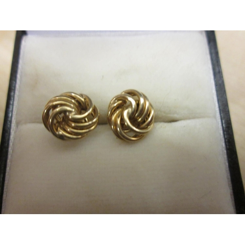 69 - Pair of 9 ct gold knot shape earrings...