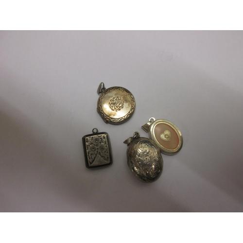 74 - 4 x silver photograph pendant lockets...