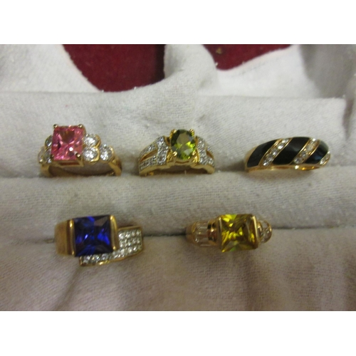 103 - Collection of five gold plated costume rings...