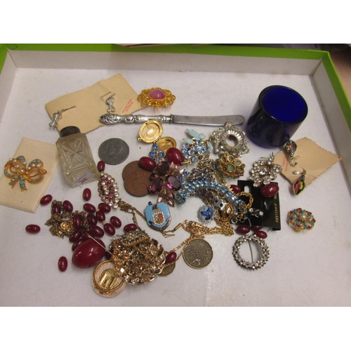 114 - Bag of assorted costume jewellery : silver rimmed scent bottle etc....