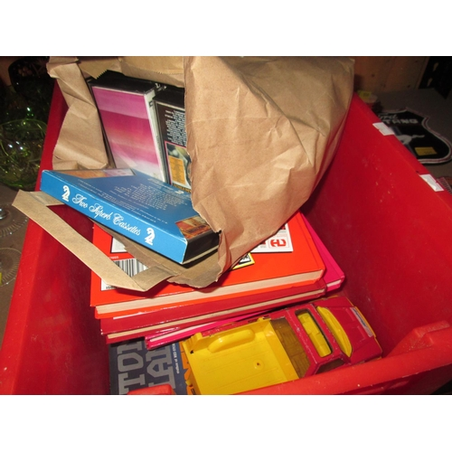214 - Box of oddments : toy cars, books, tapes etc....