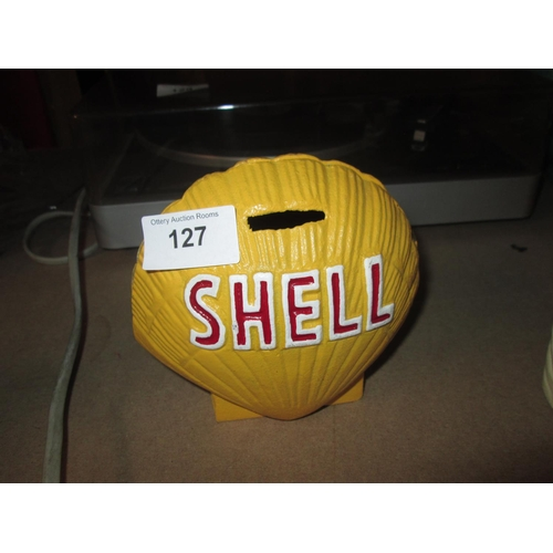 241 - Cast iron Shell advertising money box...