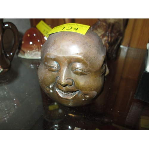 255 - Bronzed metal Chinese four faces paperweight...
