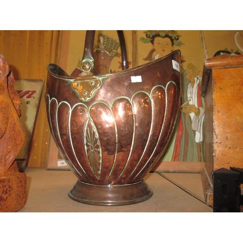 196 - 19th century lobed copper coal helmet with brass seam...